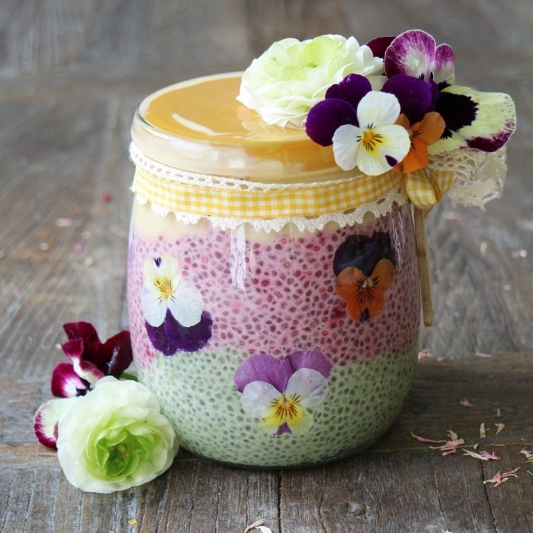 Layered Ombre Chia Pudding Parfait in paste colors, decorated with edible flowers. Recipe on breakfastwithflowers.com