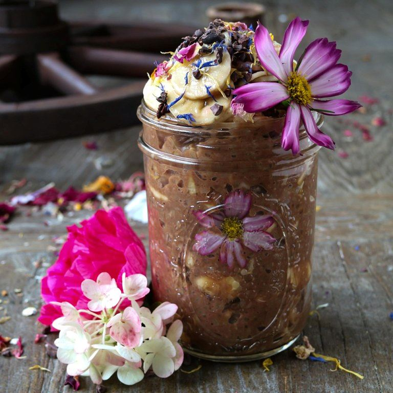 Mochi Rice Pudding with Chocolate and Banana, decorated with edible flowers. This recipe is gluten-free and vegan.