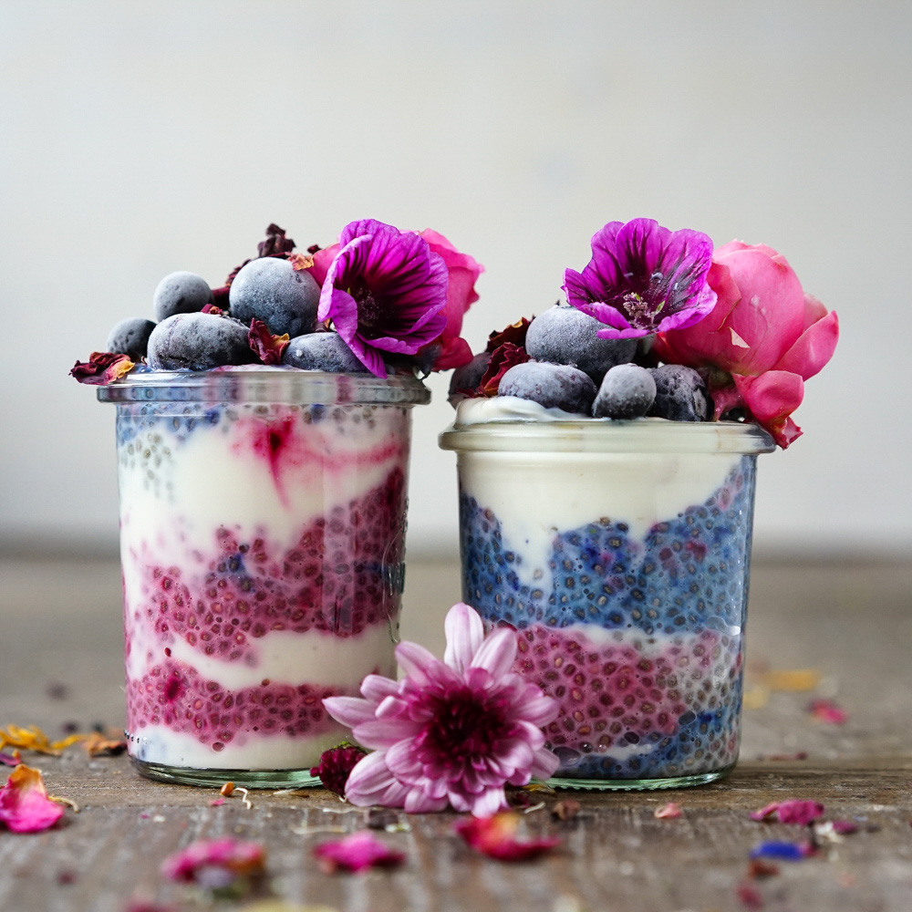 Chia Pudding with beet powder and butterfly pea flower, decorated with edible flowers. This recipe is gluten-free and vegan.